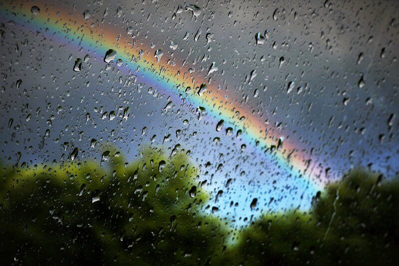 Rainbow shining through the rain